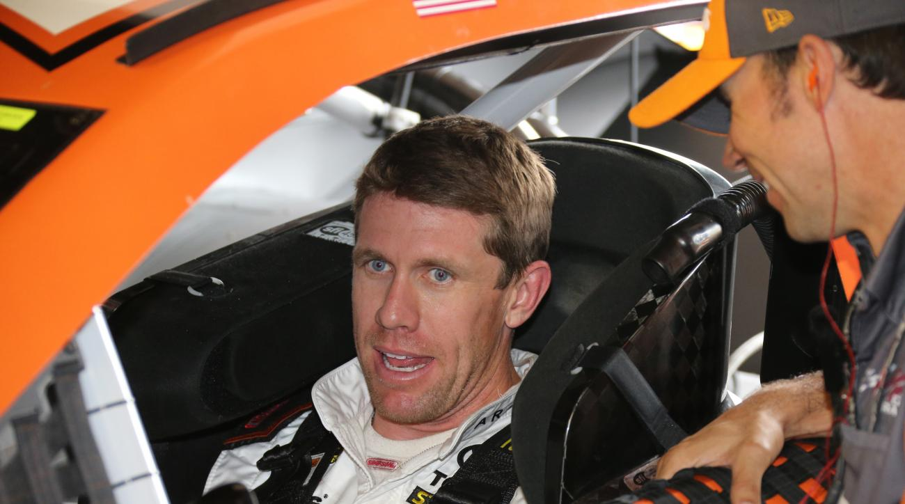 Carl Edwards sits in his car before practicing for Sunday's NASCAR Sprint Cup series auto race at Michigan International Speedway, Friday, June 12, 2015, in Brooklyn, Mich. (AP Photo/Bob Brodbeck)