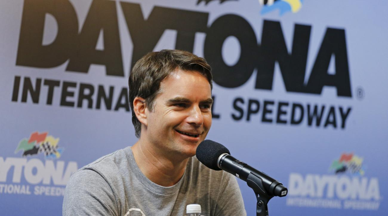Jeff Gordon answers questions during a news conference after qualifying for the NASCAR Sprint Cup Series was canceled at Daytona International Speedway, Saturday, July 4, 2015, in Daytona Beach, Fla. (AP Photo/Terry Renna)