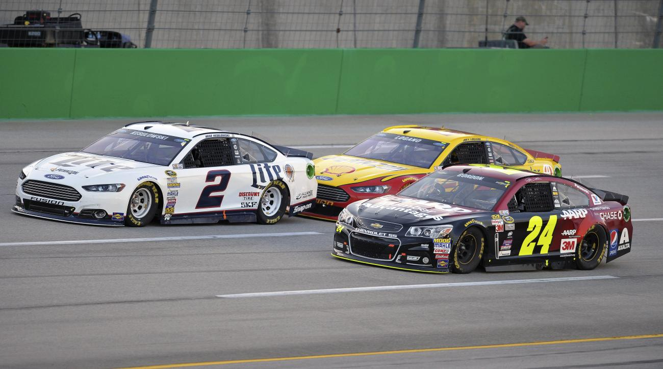 Brad Keselowski (2), Jeff Gordon (24), and Joey Logano drive at the front of the field in the early laps of the NASCAR Sprint Cup series auto race at Kentucky Speedway in Sparta, Ky., Saturday, July 11, 2015. (AP Photo/Timothy D. Easley)