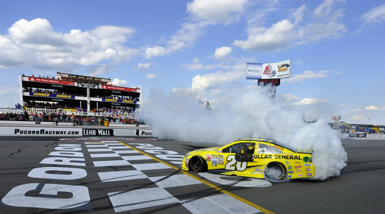 Matt Kenseth smokes his tires after winning the NASCAR Pocono 400 auto race, Sunday, Aug. 2, 2015, in Long Pond, Pa. (AP Photo/Derik Hamilton)