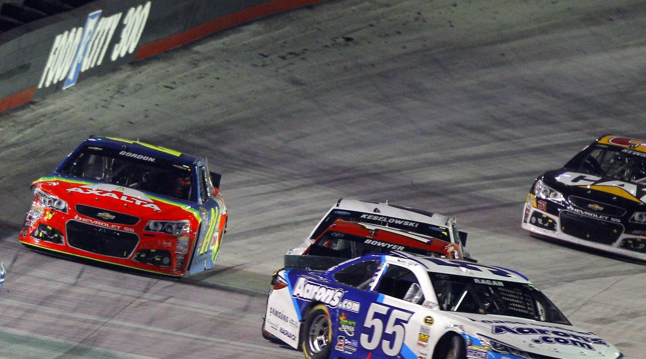 David Ragan (55) gets sideways in front of Clint Bowyer during the NASCAR Sprint Cup Series auto race, Saturday, Aug. 22, 2015, in Bristol, Tenn. (AP Photo/Wade Payne)