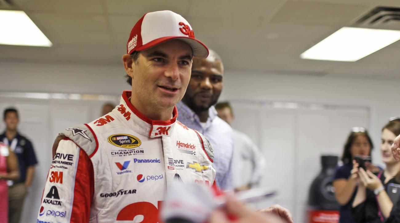 Driver Jeff Gordon gets ready to sign autographs after practice for the NASCAR Sprint Cup auto race at Richmond International Raceway in Richmond, Va., Friday, Sept. 11, 2015. (AP Photo/Chet Strange)