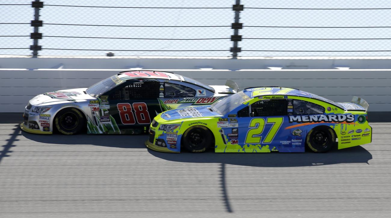 Dale Earnhardt Jr., left, drives past Paul Menard during the NASCAR Sprint Cup Series auto race at Chicagoland Speedway, Sunday, Sept. 20, 2015, in Joliet, Ill. (AP Photo/Nam Y. Huh)