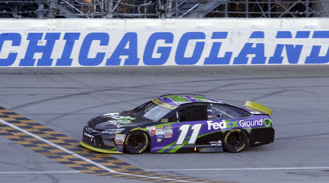 Denny Hamlin crosses the finish line as he wins the NASCAR Sprint Cup Series auto race at Chicagoland Speedway, Sunday, Sept. 20, 2015, in Joliet, Ill. (AP Photo/Nam Y. Huh)
