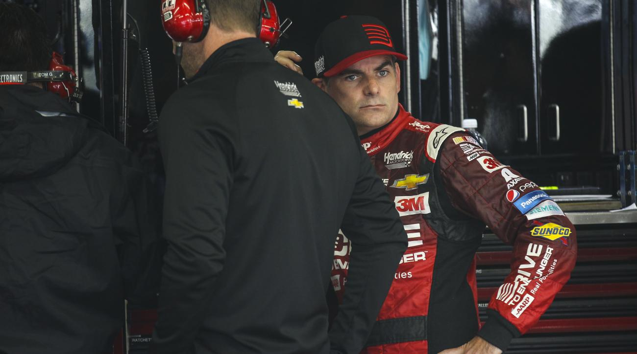 Driver Jeff Gordon waits while his car is worked on during practice for the NASCAR Sprint Cup series auto race at New Hampshire Motor Speedway, Loudon, N.H., Friday, Sept. 25, 2015  (AP Photo/Cheryl Senter)