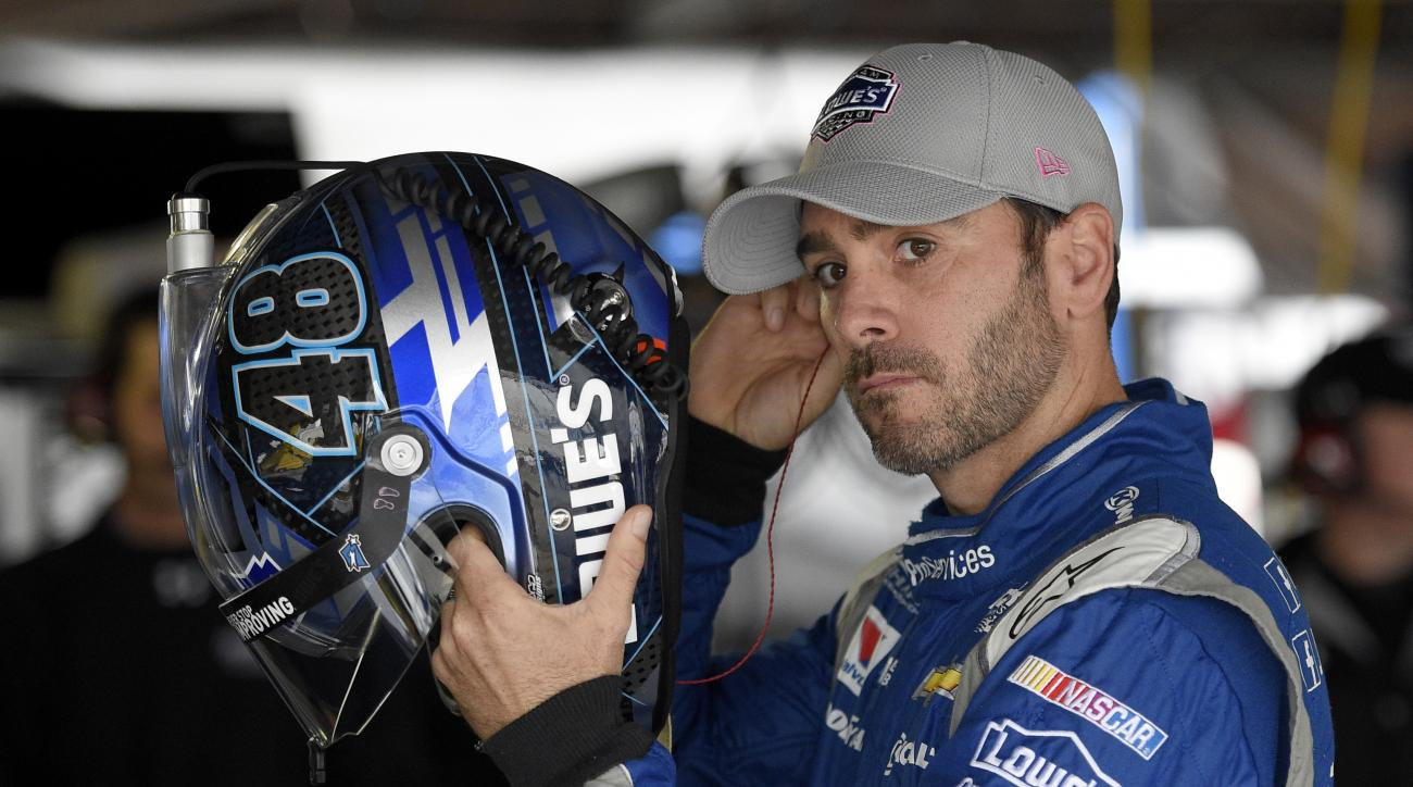 Jimmie Johnson gets ready before practice for the NASCAR Sprint Cup series auto race, Saturday, Oct. 3, 2015, at Dover International Speedway in Dover, Del. (AP Photo/Nick Wass)