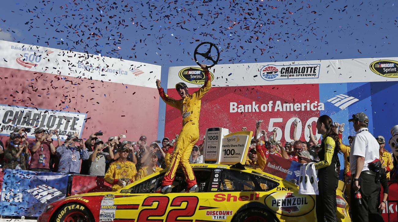 Joey Logano celebrates in Victory Lane after winning the NASCAR Sprint Cup series auto race at Charlotte Motor Speedway in Concord, N.C., Sunday, Oct. 11, 2015. (AP Photo/Chuck Burton)