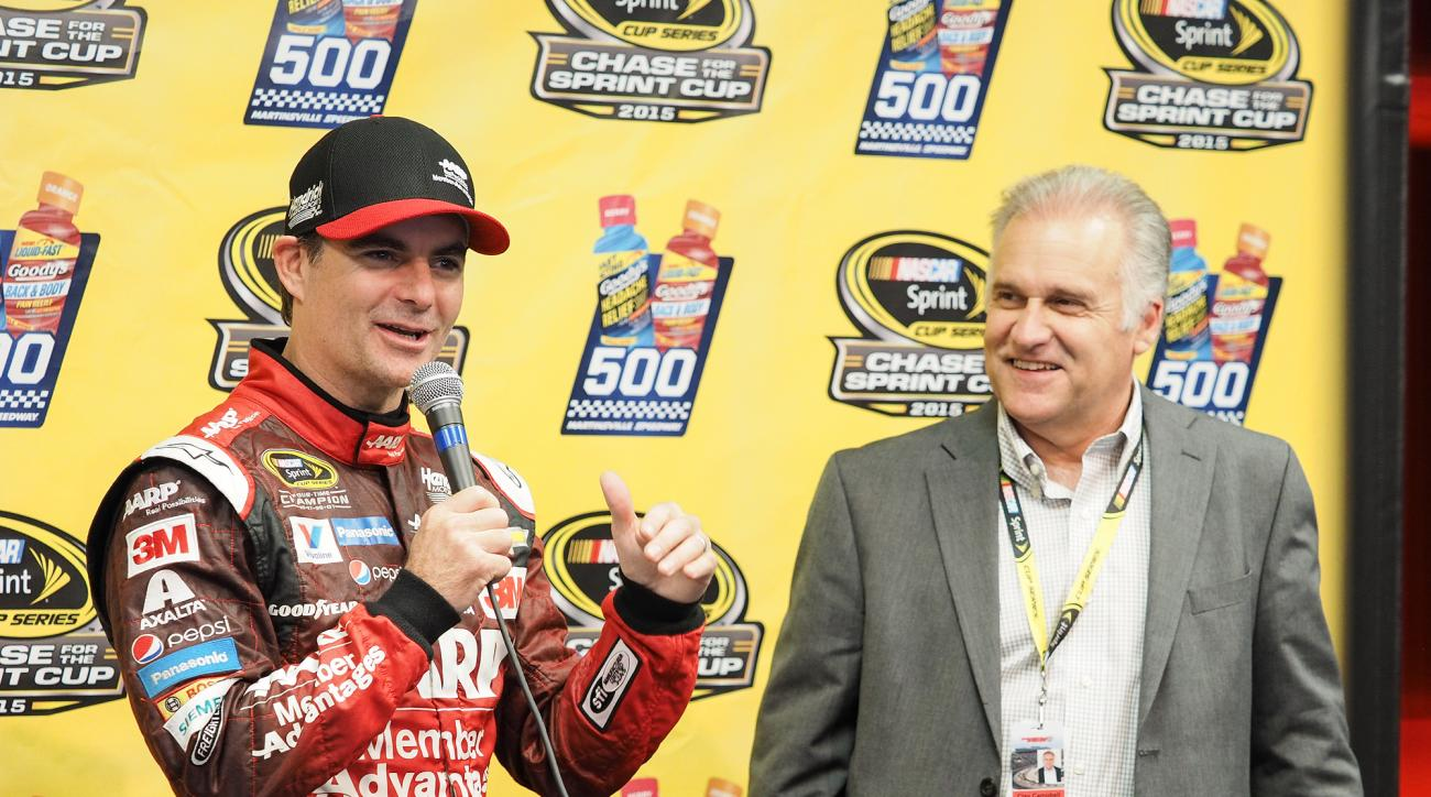 NASCAR Sprint Cup driver Jeff Gordon is given a train with eight cars, one for every race he has won at Martinsville Speedway, by track President Clay Campbell, right, during a press conference for Sunday's NASCAR Sprint Cup auto race at Martinsville Spee