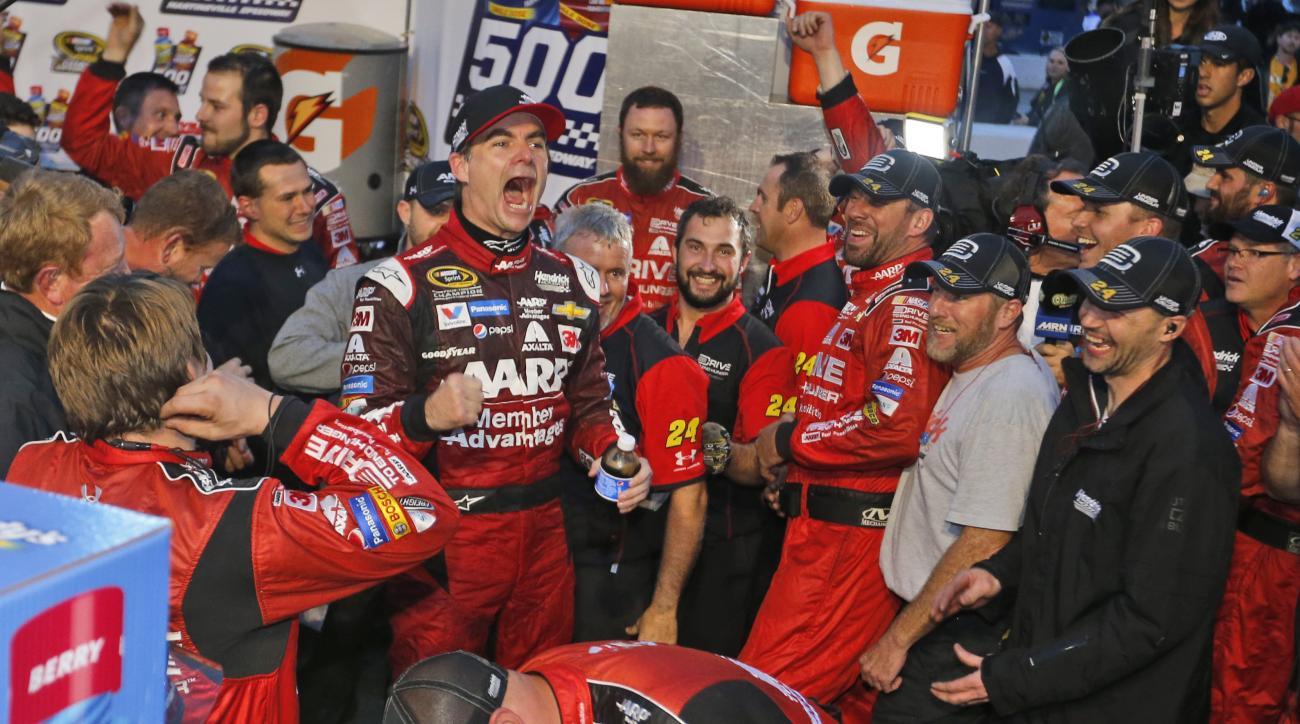 Jeff Gordon celebrates winning the Sprint Cup auto race at Martinsville Speedway in Martinsville, Va., Sunday, Nov. 1, 2015. (AP Photo/Steve Helber)