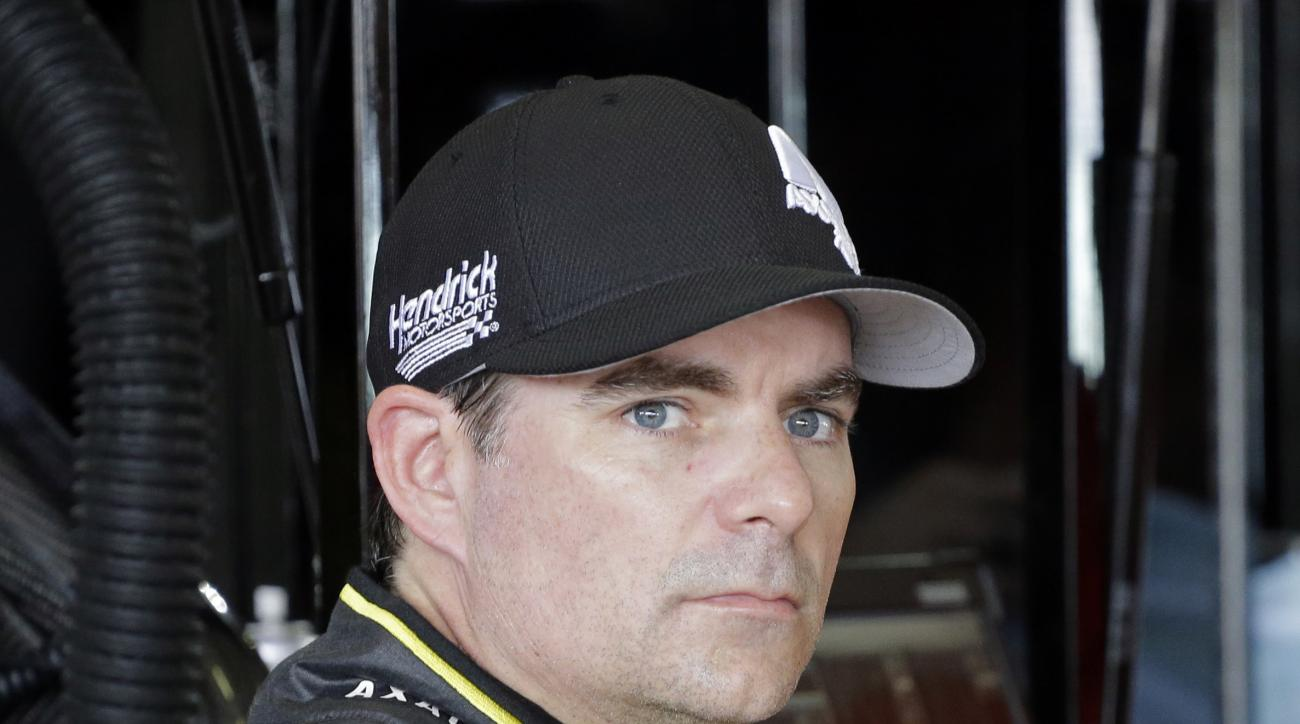 Jeff Gordon looks on in the garage area before the NASCAR Sprint Cup Series practice auto race, Saturday, Nov. 21, 2015, at Homestead-Miami Speedway in Homestead, Fla. (AP Photo/Terry Renna)