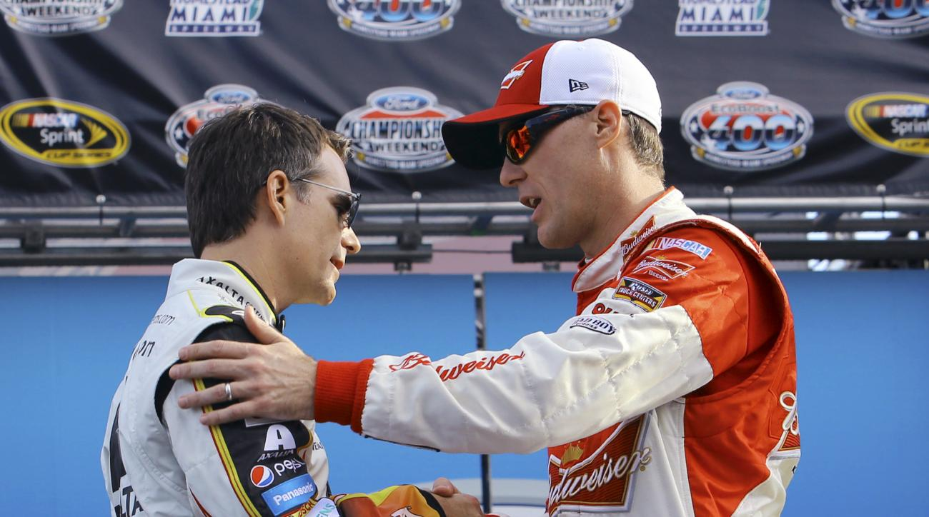 Jeff Gordon, left, and Kevin Harvick shake hands during the driver introductions for the NASCAR Sprint Cup Series auto race, Sunday, Nov. 22, 2015, at Homestead-Miami Speedway in Homestead, Fla. (AP Photo/David  Graham)
