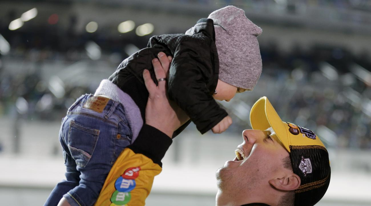 Kyle Busch plays with his son, Brexton Locke Busch before he gets in his car for the start of the Sprint Unlimited auto race at Daytona International Speedway, Saturday, Feb. 13, 2016, in Daytona Beach, Fla. (AP Photo/Terry Renna)