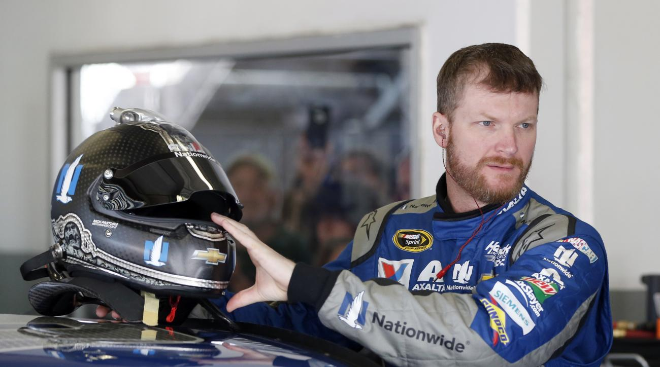 Dale Earnhardt Jr prepares to climb into his car during practice for Sunday's NASCAR Daytona 500 Sprint Cup series auto race at Daytona International Speedway in Daytona Beach, Fla., Friday, Feb. 19, 2016. (AP Photo/Wilfredo Lee)