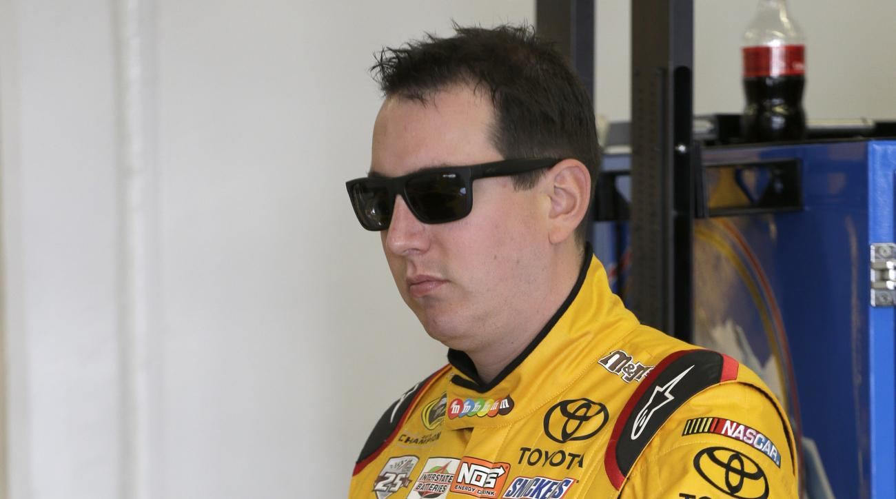 Kyle Busch waits outside his car during practice for Sunday's NASCAR Daytona 500 Sprint Cup series auto race at Daytona International Speedway in Daytona Beach, Fla., Friday, Feb. 19, 2016. (AP Photo/Terry Renna)