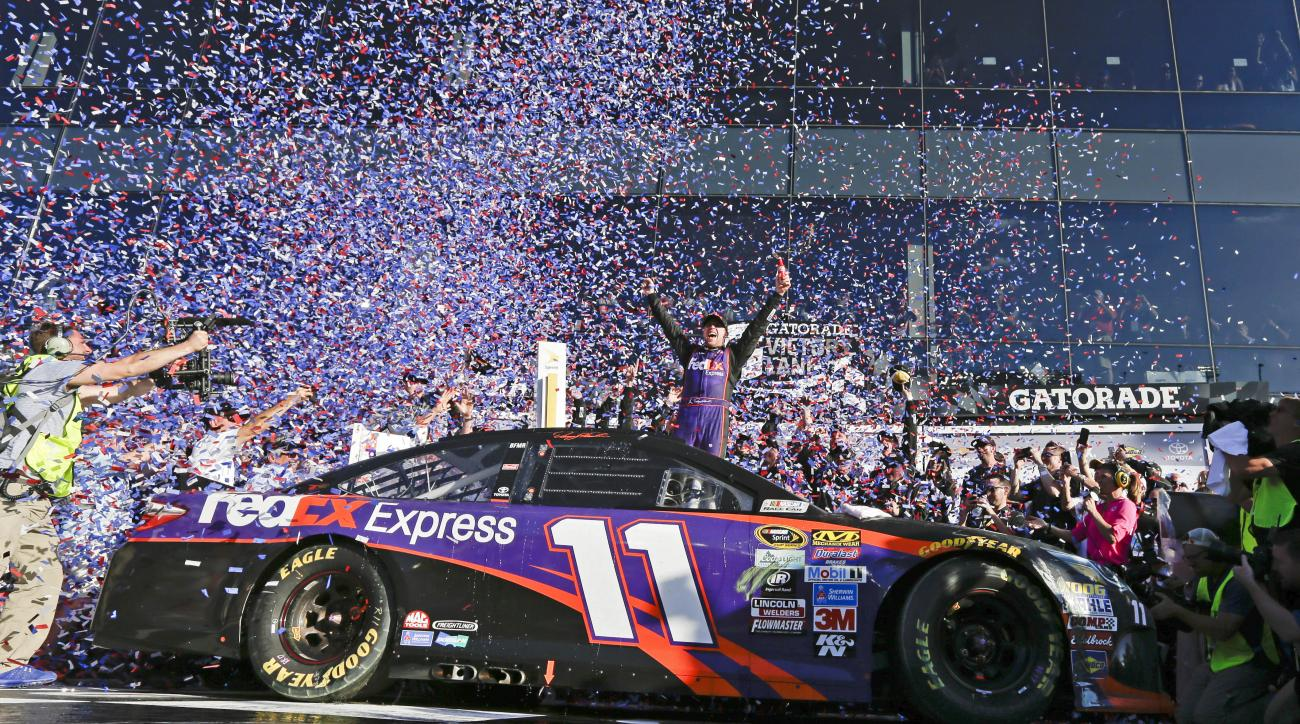 Denny Hamlin celebrates in Victory Lane after winning the NASCAR Daytona 500 Sprint Cup Series auto race at Daytona International Speedway in Daytona Beach, Fla., Sunday, Feb. 21, 2016. (AP Photo/Chuck Burton)