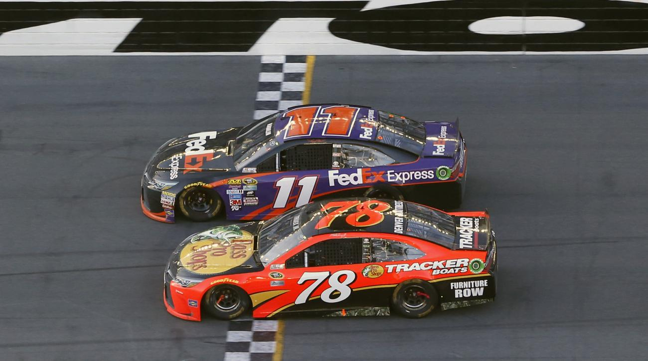 Denny Hamlin (11) beats out Martin Truex Jr. (78) at the finish line to win the NASCAR Daytona 500 auto race at Daytona International Speedway, Sunday, Feb. 21, 2016, in Daytona Beach, Fla. (AP Photo/Wilfredo Lee)