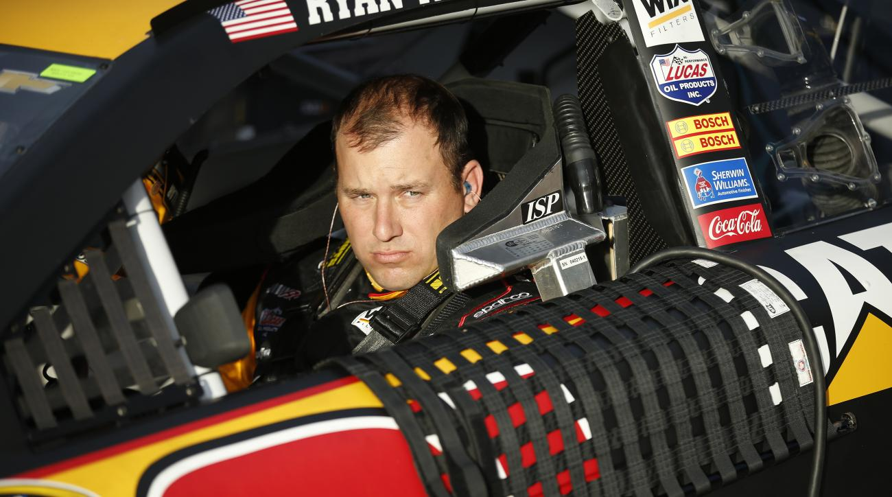 Ryan Newman sits in his car before qualifying for the NASCAR Sprint Cup Series auto race Friday, March 4, 2016, in Las Vegas. (AP Photo/John Locher)