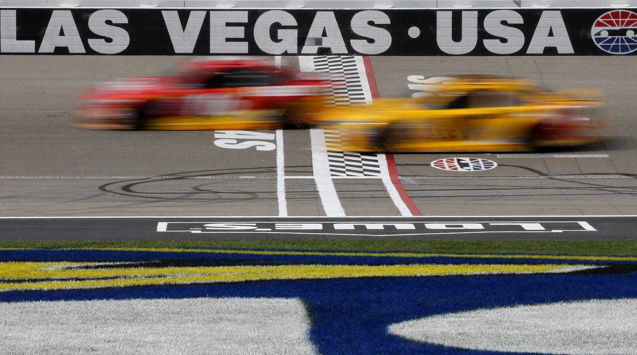 Cars cross the start/finish line during a NASCAR Sprint Cup Series auto race Sunday, March 6, 2016, in Las Vegas. (AP Photo/John Locher)