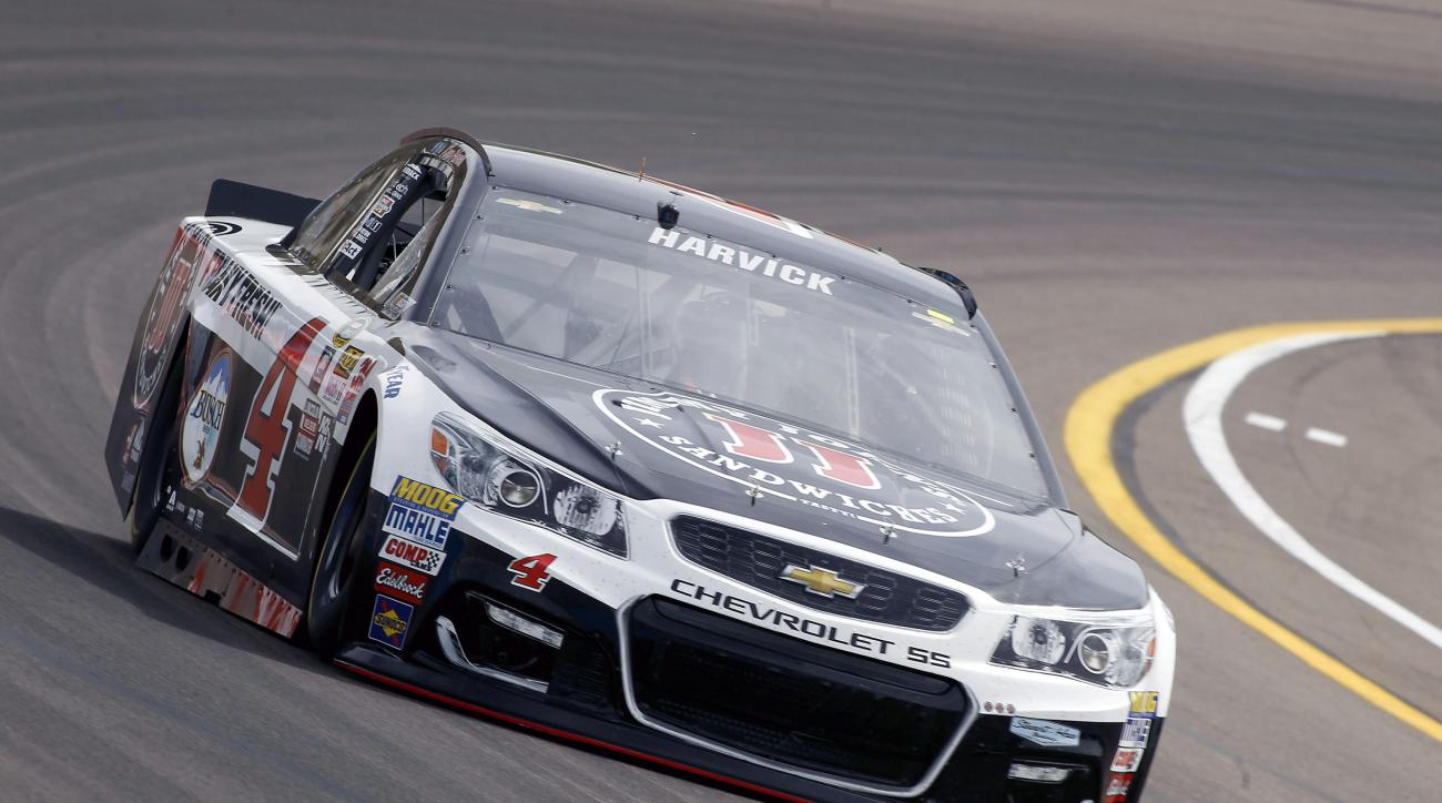 Kevin Harvick drives out of Turn 4 during NASCAR Sprint Cup Series practice at Phoenix International Raceway, Friday, March 11, 2016, in Avondale, Ariz. (AP Photo/Ralph Freso)