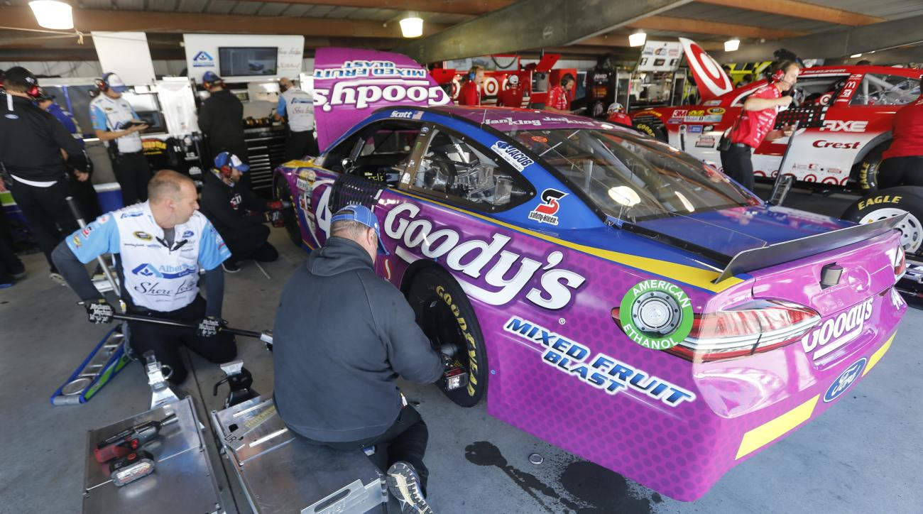 Brian Scott's crew works on his car during the final practice for Sunday's NASCAR Sprint Cup Series auto race at the Martinsville Speedway Saturday, April 2, 2016 in Martinsville, Va. Scott is making his first Sprint Cup start on Sunday. (AP Photo/Steve H