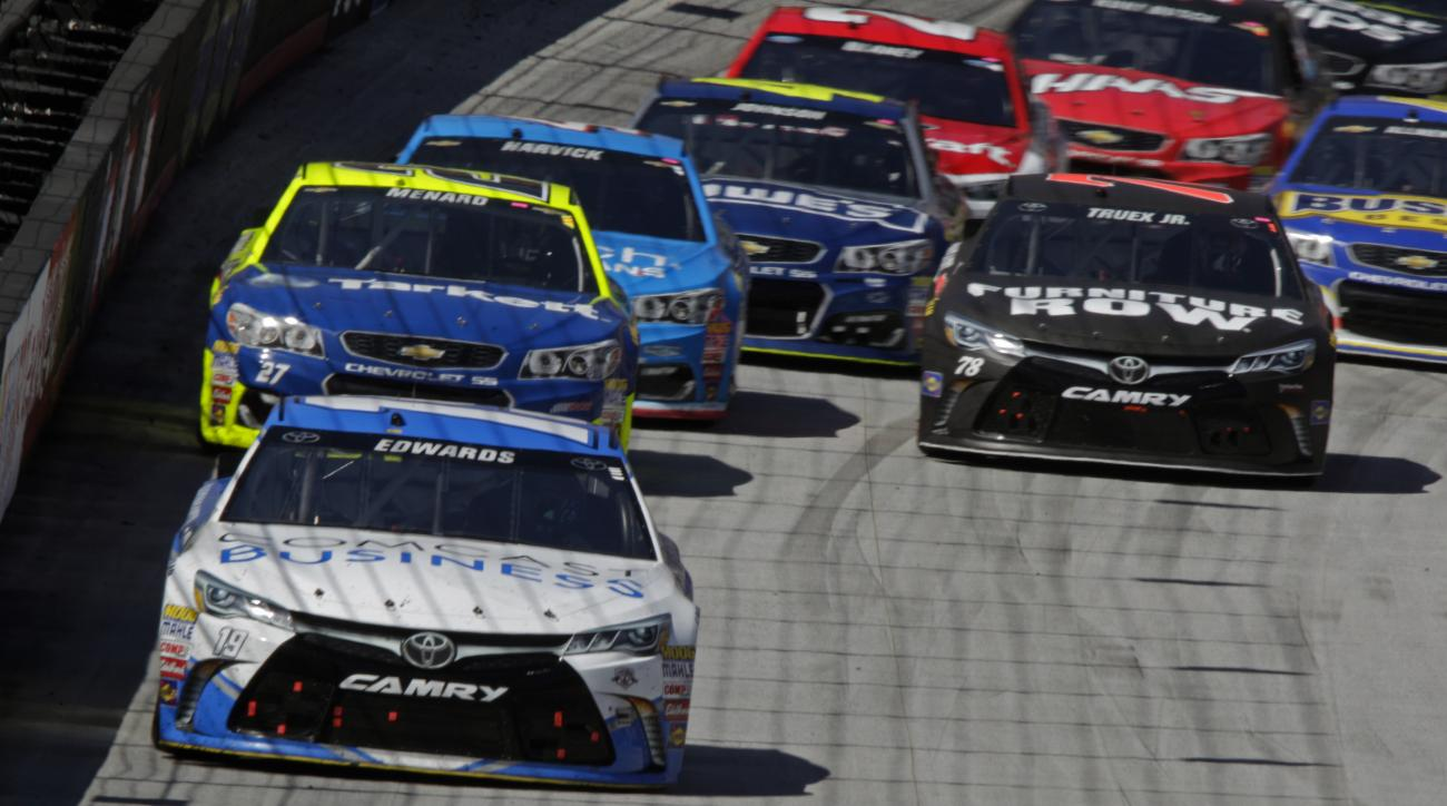 Sprint Cup Series driver Carl Edwards (19) leads the field during a NASCAR Sprint Cup Series auto race, Sunday, April 17, 2016, in Bristol, Tenn. (AP Photo/Wade Payne)