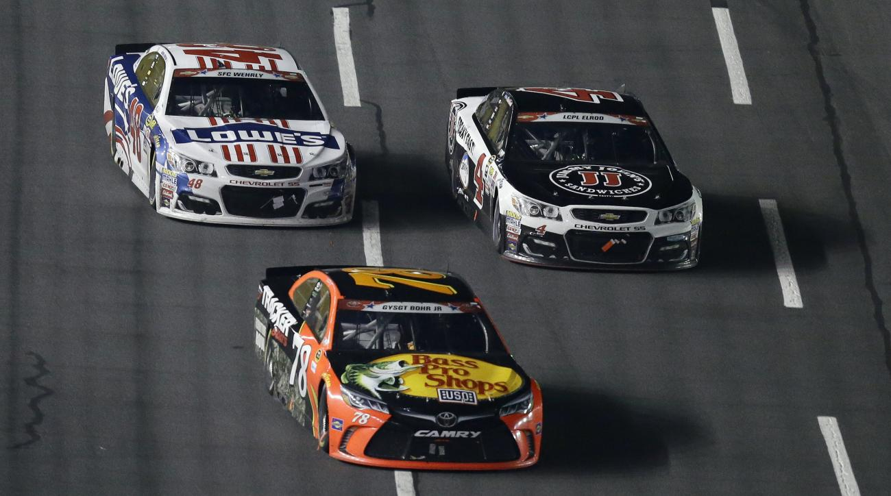 Martin Truex Jr. (78) leads Jimmie Johnson, left, and Kevin Harvick (4) following a restart late in the NASCAR Sprint Cup Series auto race at the Charlotte Motor Speedway in Concord, N.C., Sunday, May 29, 2016. True Jr. won the race. (AP Photo/Gerry Broom