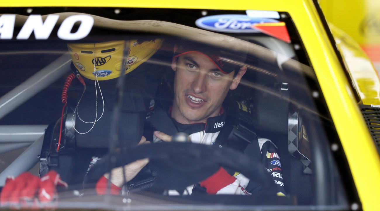 Driver Joey Logano prepares for a practice session for the NASCAR Sprint Cup series auto race at Michigan International Speedway, Saturday, June 11, 2016 in Brooklyn, Mich. (AP Photo/Carlos Osorio)