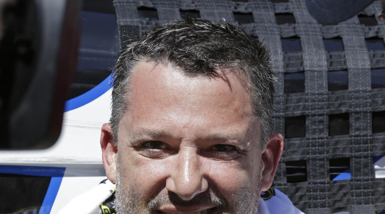 Tony Stewart speaks during an interview after winning the NASCAR Sprint Cup Series auto race Sunday, June 26, 2016, in Sonoma, Calif. (AP Photo/Ben Margot)