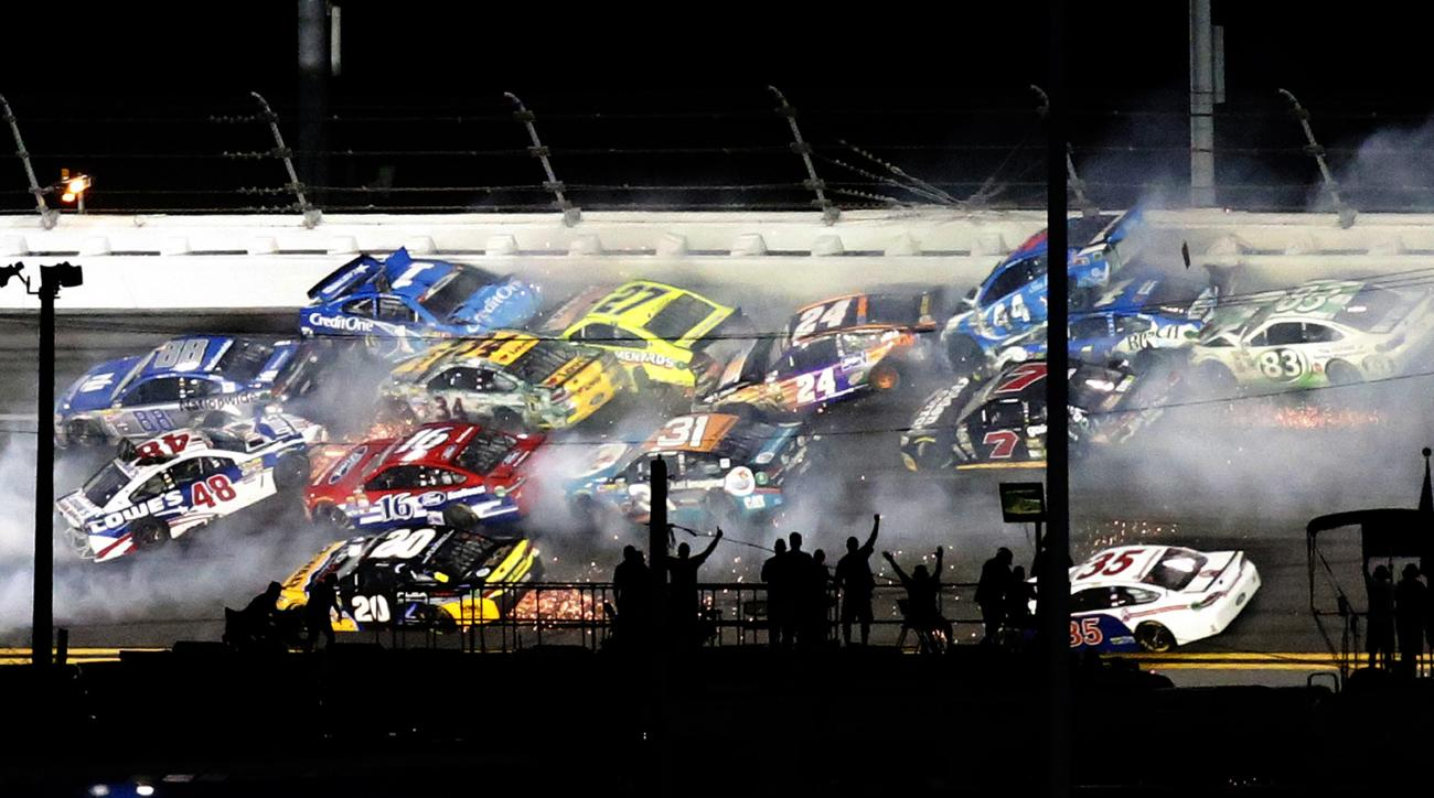 Several cars are involved in a crash on Turn 1 during the NASCAR Sprint Cup auto race at Daytona International Speedway, Saturday, July 2, 2016, in Daytona Beach, Fla. (AP Photo/Wilfredo Lee)