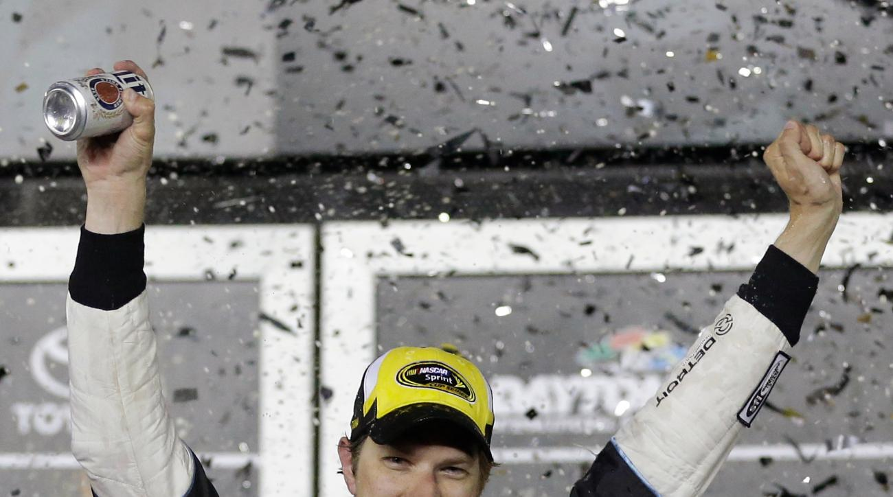 Brad Keselowski celebrates in Victory Lane after winning the NASCAR Sprint Cup Series auto race at Daytona International Speedway, Saturday, July 2, 2016, in Daytona Beach, Fla. (AP Photo/John Raoux)