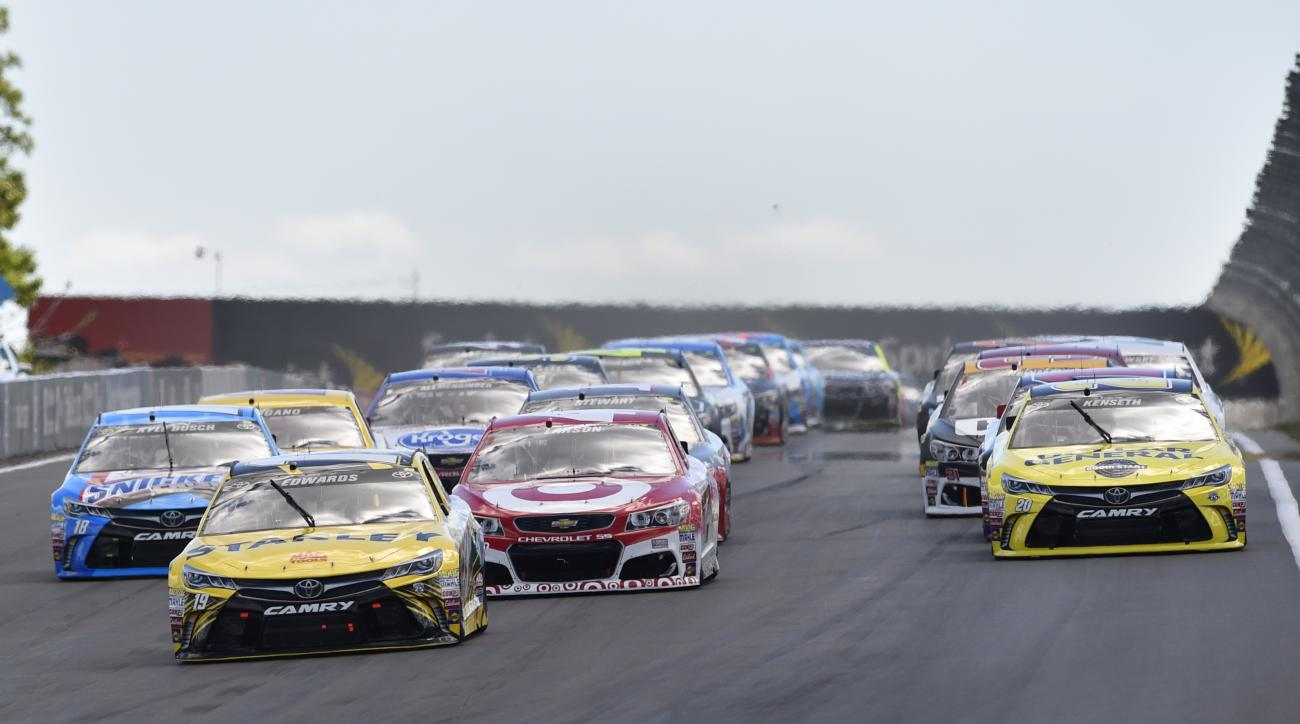 Carl Edwards (19) leads the field into Turn 1 during a NASCAR Sprint Cup series auto race at Watkins Glen International, Sunday, Aug. 7, 2016, in Watkins Glen, N.Y. (AP Photo/Derik Hamilton)