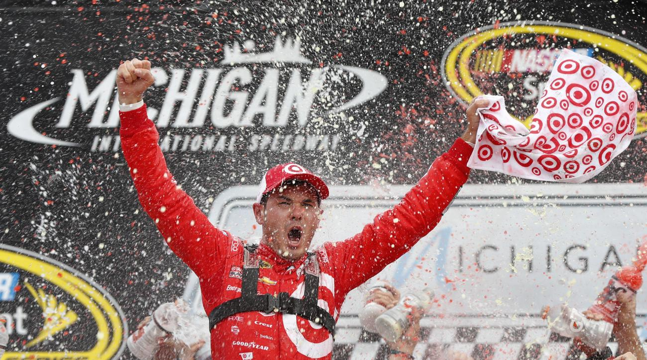 Kyle Larson celebrates after  winning the NASCAR Sprint Cup Series auto race at Michigan International Speedway in Brooklyn, Mich., Sunday, Aug. 28, 2016. (AP Photo/Paul Sancya)