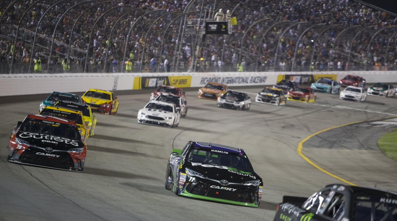 Denny Hamlin rounds Turn 1 followed by Martin Truex Jr. during the NASCAR Sprint Cup auto race at Richmond International Raceway in Richmond, Va., Saturday, Sept. 10, 2016. (AP Photo/Chet Strange)