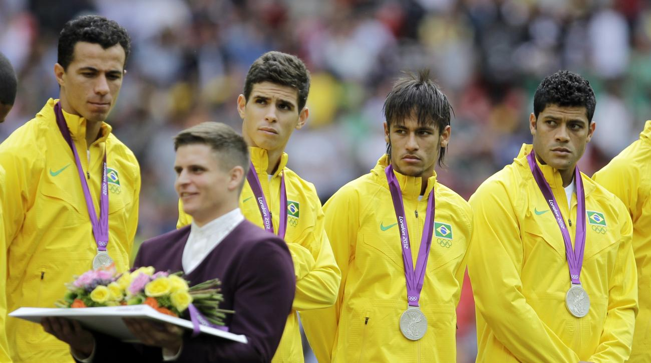 FILE - In this Aug. 11, 2012 file photo, Brazil players stand on the podium after receiving their silver medal during a ceremony following their loss to Mexico in the men's soccer final at the 2012 Summer Olympics, in London. Brazil may be on track for a