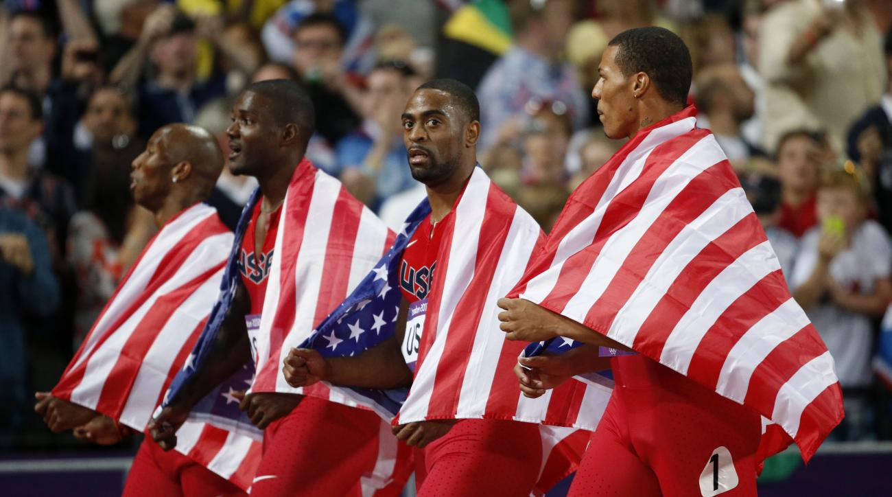 FILE - In this Saturday, Aug. 11, 2012 file photo, from left, United States' 4x100-meter relay team Trell Kimmons, Justin Gatlin, Tyson Gay and Ryan Bailey walk on the track taking the silver medal during the athletics in the Olympic Stadium at the 2012 S