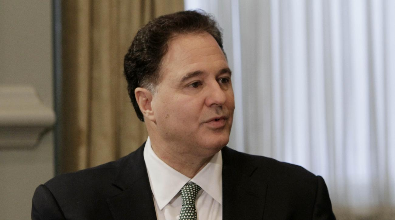 FILE - In this Dec. 2, 2010, file photo, Steve Pagliuca, managing director of Bain Capital, speaks during a conference at the New York Stock Exchange in New York. The group leading the bid to bring the 2024 Olympics to Boston shook up its management Thurs