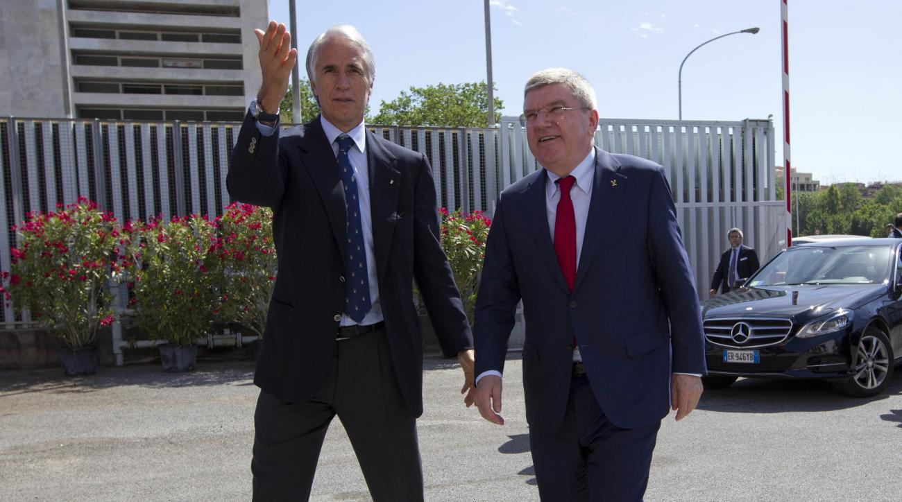International Olympic Committee, IOC, president Thomas Bach, right, is greeted by  Italian Olympic Committee, CONI, president Giovanni Malago, as he arrives to visit the Rome 2014 Olympic bid headquarters, in Rome, Friday, May 22, 2015. Bach said Rome's h