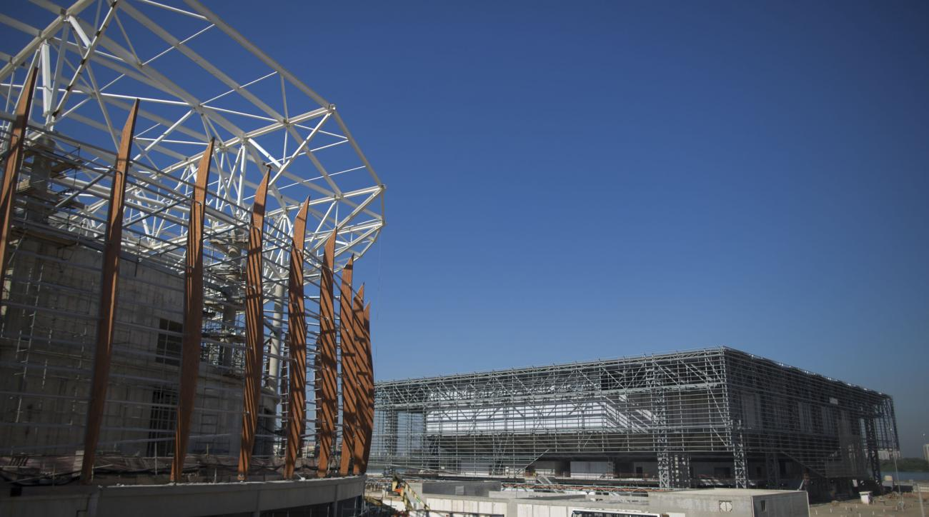 The Arena do Futuro, that will host handball games, right, and Arena Carioca 1, left, are seen under construction at the Olympic Park of the 2016 Olympics in Rio de Janeiro, Brazil, Thursday, June 11, 2015. Rio will host the Olympic Games in 2016. (AP Pho