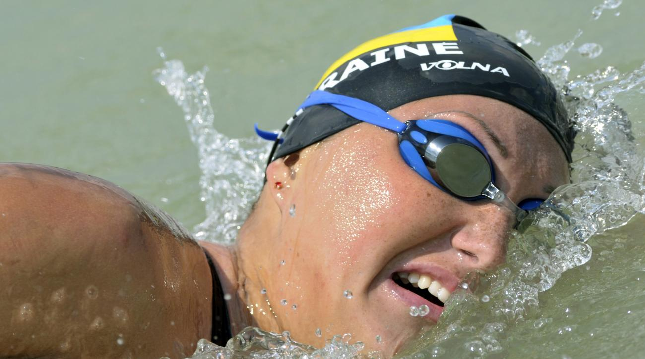 FILE - In this Sunday, Aug. 8, 2010 file photo, Olga Beresnyeva of Ukraine competes during the women's 25km open water race of the European Swimming Championships at the lake Balaton in Balatonfuered, Hungary. The IOC has retroactively disqualified a Ukra