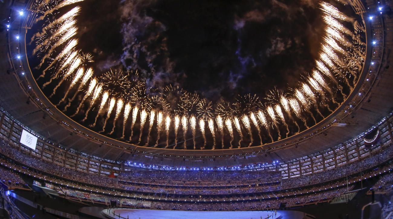 Fireworks explode over the stadium as actors perform during the opening ceremony of the 2015 European Games in Baku, Azerbaijan, Friday, June 12, 2015. (AP Photo/Dmitry Lovetsky)