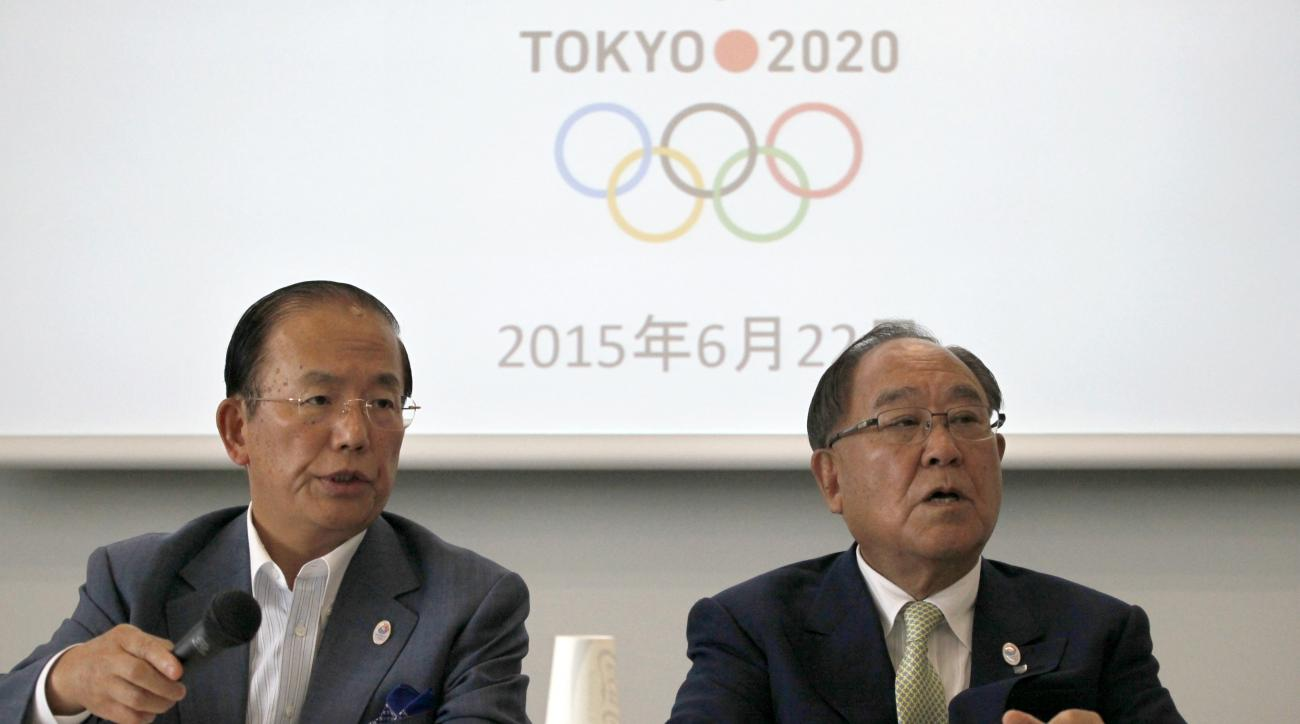 Tokyo 2020 Olympics CEO Toshiro Muto, left, and Honorary President Fujio Mitarai speak during a news conference in Tokyo, Monday, June 22, 2015, to announce that eight sports have been shortlisted for possible addition at the Tokyo summer games. The Tokyo