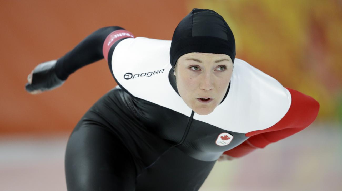 FILE - In this Feb. 5, 2014, file photo, Canada's Anastasia Bucsis skates during a test race at the Adler Arena Skating Center at the 2014 Winter Olympics in Sochi, Russia. Moments before Bucsis stepped on the ice, she was consumed by worries that went wa