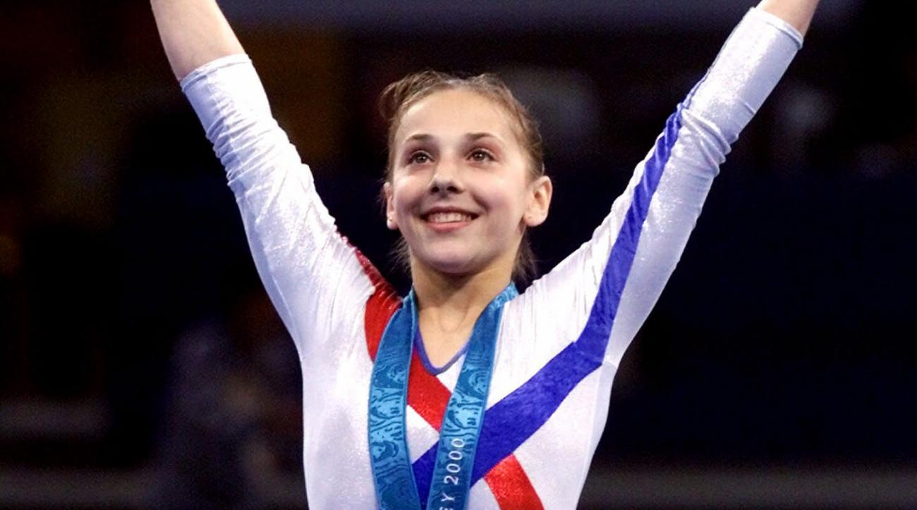 FILE - In this Thursday, Sept. 21, 2000 file photo, Andreea Raducan of Romania, receives her gold medal in the women's all-around gymnastics competition at the Olympics in Sydney, Australia. Former gymnast Andreea Raducan is still trying to get her Olympi
