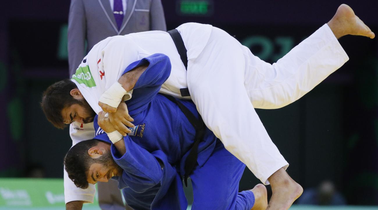 Adam Okruashvili of Georgia, above, and Or Sasson of Israel compete in the men's judo , -100kg  Golg medal final at the 2015 European Games in Baku, Azerbaijan, Saturday, June 27, 2015. (AP Photo/Dmitry Lovetsky)