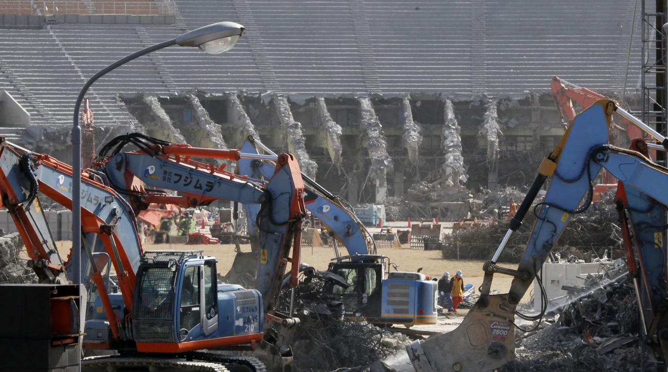 FILE - In this March 5, 2015 file photo, Japan's National Stadium is dismantled for the renovation for the 2020 Tokyo Olympic Games, in Tokyo. When the dust settles on the marquee venue for the 2020 Summer Olympics in Tokyo, it could well be the most expe