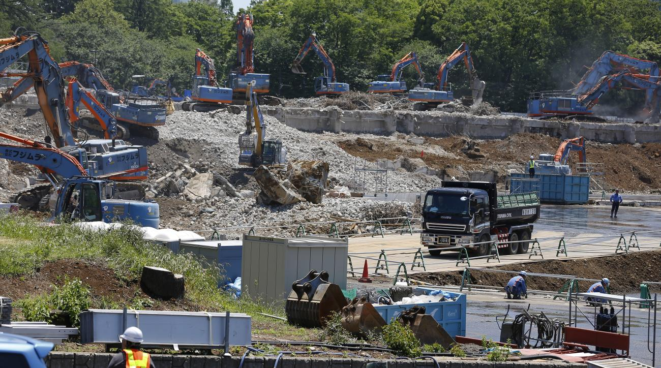 FILE - In this May 13, 2015 file photo, Japan's National Stadium is dismantled for the renovation for the 2020 Tokyo Olympic Games, in Tokyo. When the dust settles on the marquee venue for the 2020 Summer Olympics in Tokyo, it could well be the most expen
