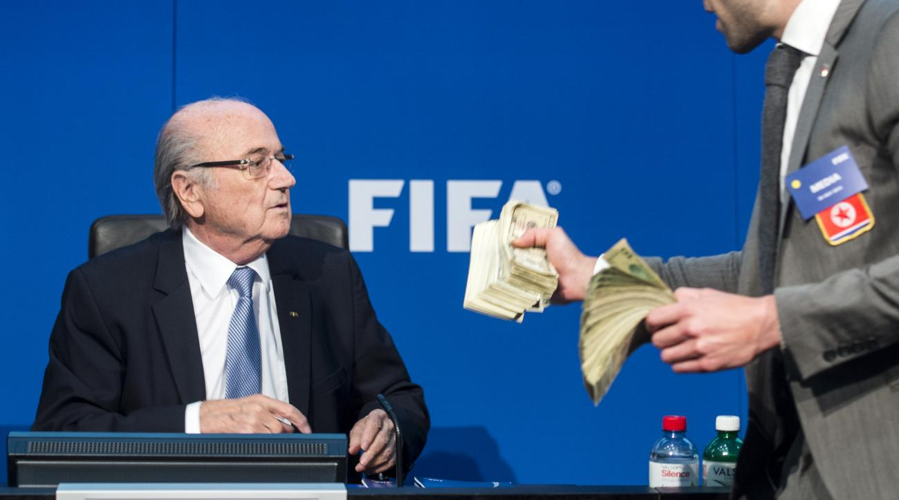 FIFA president Sepp  Blatter, left,  next to British comedian Simon Brodkin  attends  a news s conference  at the FIFA   headquarters in Zurich, Switzerland, Monday, July 20, 2015. Sepp Blatter's news conference  was disrupted and delayed Monday by the  B