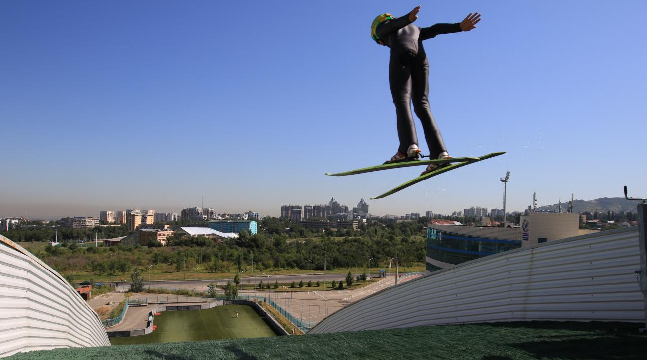 FOR STORY 2022 BID - In this photo taken on Tuesday, July  14, 2015, an athlete trains at the Sunkar International Ski Jumping Complex in Almaty, Kazakhstan.  The ex-Soviet nation of Kazakhstan in Central Asia will be the first majority-Muslim country to