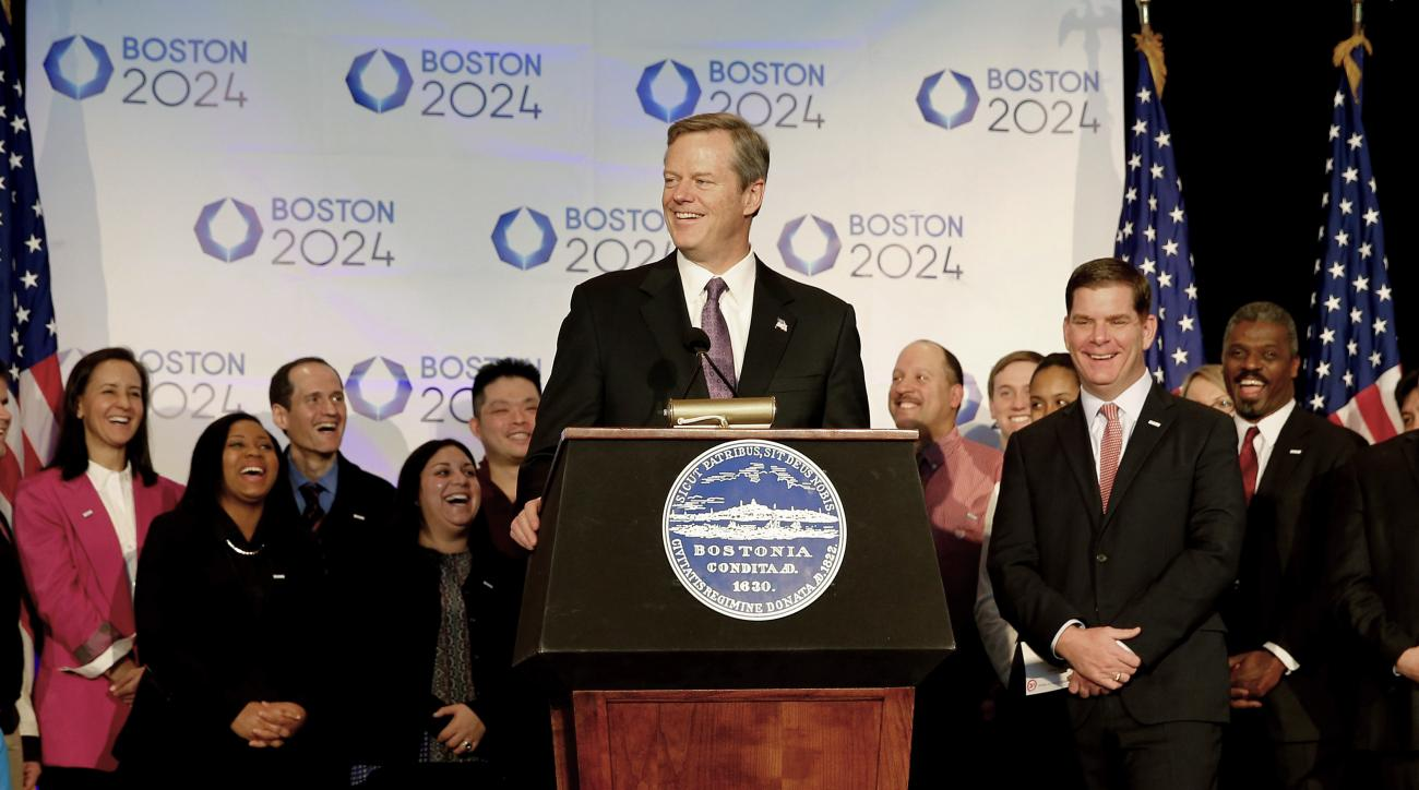 FILE - In this Jan. 9, 2015, file photo,  Massachusetts Gov. Charlie Baker speaks during a news conference in Boston, as Boston Mayor Martin Walsh, second from right, and other looks on, after Boston was picked by the USOC as its bid city for the 2024 Oly