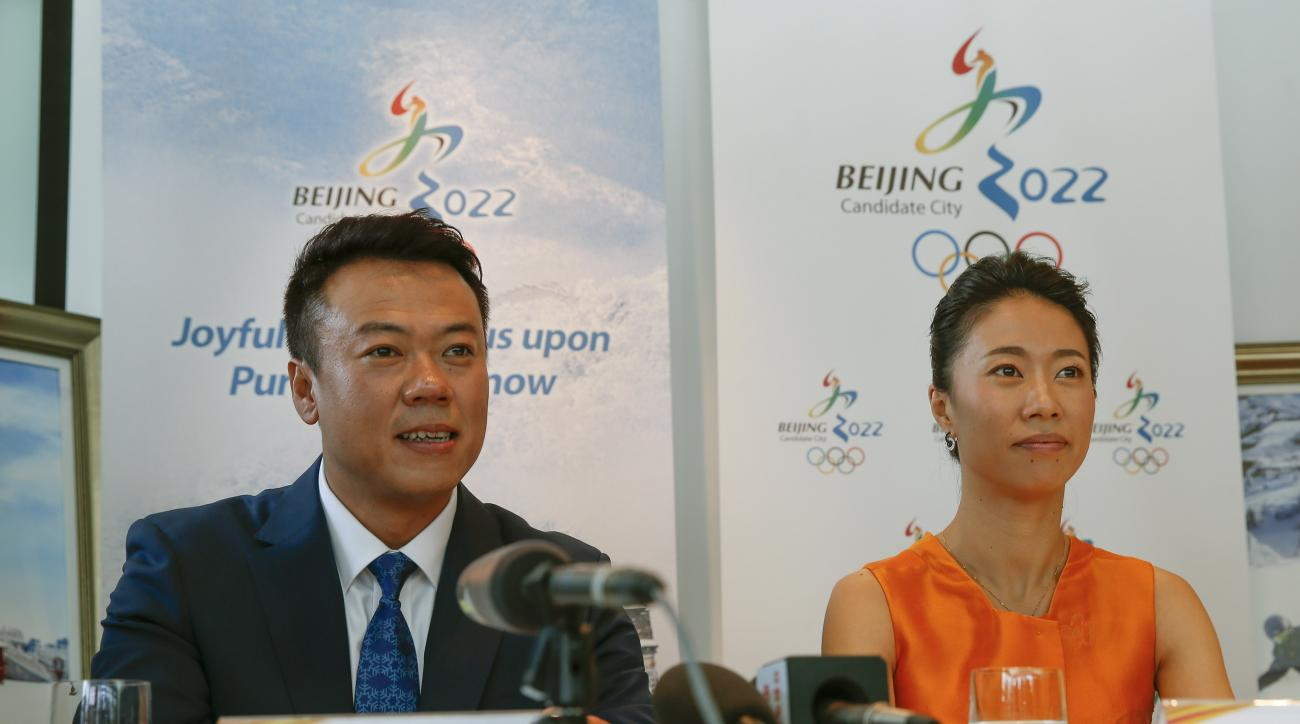 China's Olympic gold medalist figure skating pair, Shen Xue, right, and Zhao Hongbo, speak to the media during a press conference in Kuala Lumpur, Malaysia,Tuesday, July, 28, 2015. Malaysia is hosting the 128th International Olympic Committee executive bo